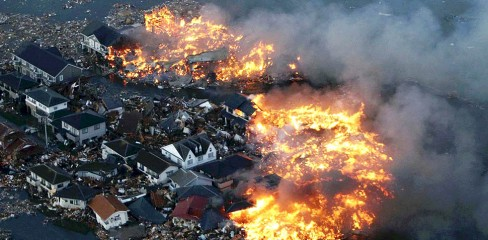 This aerial shot shows houses in flame a