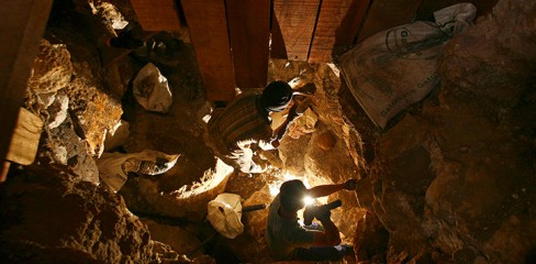 Poboya, Indonesia: Miners mine for gold in an illegal gold mine